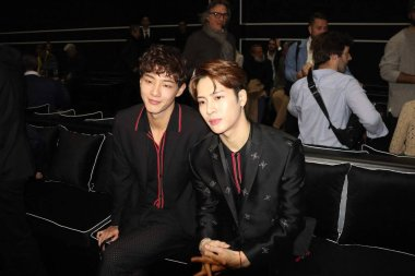 Hong Kong singer and actor Jackson Wang of South Korean boy group GOT7, right, attends the Fendi fashion show during the Milan Men's Fashion Week Fall/Winter 2019 in Milan, Italy, 14 January 2019.