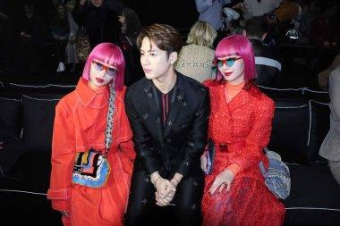 Hong Kong singer and actor Jackson Wang of South Korean boy group GOT7, center, and Aya Amiaya and Ami Amiaya of Japanese music duo of twin sisters Amiaya attend the Fendi fashion show during the Milan Men's Fashion Week Fall/Winter 2019 in Milan, It