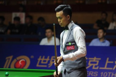 David Gilbert of England considers a shot against Marco Fu of Hong Kong during their first round match of the 2016 World Snooker Shanghai Masters in Shanghai, China, 19 September 2016