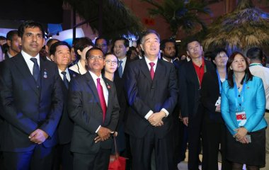 Chinese Vice Premier Wang Yang, center, and other Chinese and Maldivian officials attend the opening event of the Maldives Pavilion during the 4th China-South Asia Exposition and the 24th China Kunming Import & Export Fair in Kunming city, southwest