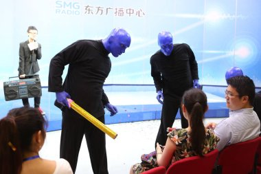 Actors of Blue Man Group perform at a press conference to promote the Shanghai show during their world tour in Shanghai, China, 14 July 2016