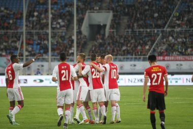 Players of AFC Ajax celebrate after scoring a goal against Liaoning Hongyun in a soccer friendly during their China tour in Shenyang city, northeast China's Liaoning province, 18 May 2016.