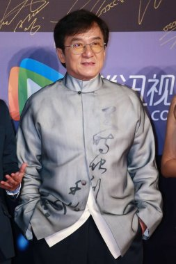 Hong Kong kungfu star Jackie Chan arrives on the red carpet for the Jackie Chan Action Movie Week gala night in Shanghai, China, 16 June 2016.