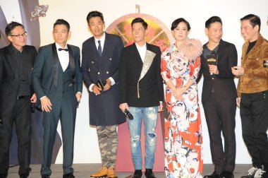 (From left) Hong Kong director and producer Andrew Lau Wai-keung, actors Andy Lau, Chow Yun-fat and Nick Cheung, actress Carina Lau, singer and actor Jacky Cheung, producer and actor Charles Heung attend a premiere event for their new movie