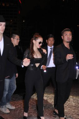 Japanese singer Ayumi Hamasaki, center, is pictured on a street after midnight in Hong Kong, China, 24 February 2016.