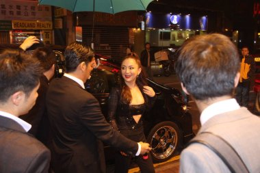 Japanese singer Ayumi Hamasaki, center, is pictured on a street before midnight in Hong Kong, China, 23 February 2016.