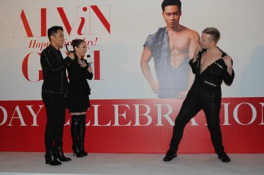 Japanese singer Ayumi Hamasaki, second left, and her stylist friend Alvin Goh, left, watch a model taking off his clothes at a celebration event for Goh's birthday in Hong Kong, China, 22 February 2016.