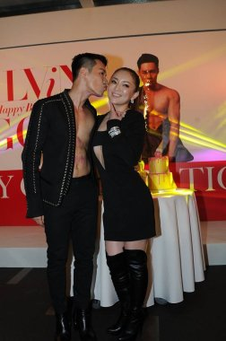 Japanese singer Ayumi Hamasaki, right, is kissed by her stylist friend Alvin Goh at a celebration event for his birthday in Hong Kong, China, 22 February 2016.