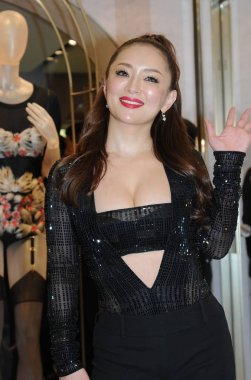 Japanese singer Ayumi Hamasaki poses during a promotional event of a lingerie brand at a store in Hong Kong, China, 23 February 2016.