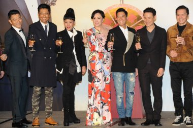 (From left) Hong Kong singer and actor Andy Lau, actor Chow Yun-fat and his wife Jasmine Tan, actress Carina Lau, actors Nick Cheung, Jacky Cheung and Charles Heung attend a premiere event for their new movie