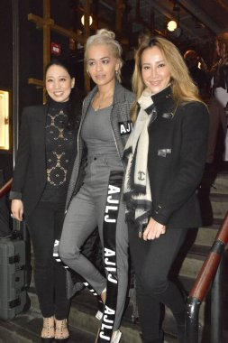 Hong Kong-born American singer Coco Lee, right, poses with British singer Rita Ora, center, as she feasts Rita at her restaurant in Hong Kong, China, 22 March 2016.
