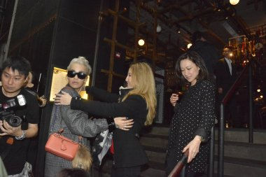 Hong Kong-born American singer Coco Lee, second right, greets British singer Rita Ora as she feasts Rita at her restaurant in Hong Kong, China, 22 March 2016.