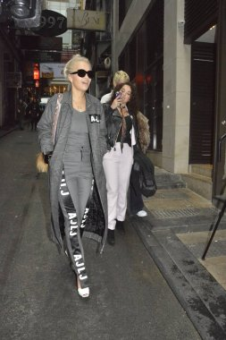 British singer Rita Ora, front, arrives at a restaurant of Hong Kong-born American singer Coco Lee in Hong Kong, China, 22 March 2016.