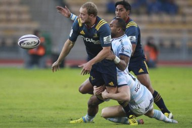 Players of France's Racing 92 (light blue) and New Zealand's Highlanders compete during the Natixis Rugby Cup Hong Kong 2016 in Hong Kong, China, 6 February 2016