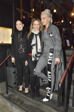 Hong Kong-born American singer Coco Lee, center, poses with British singer Rita Ora, right, as she feasts Rita at her restaurant in Hong Kong, China, 22 March 2016.