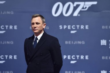 English actor Daniel Craig poses during a premiere for his movie