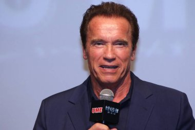 American actor Arnold Schwarzenegger speaks during a premiere for his movie