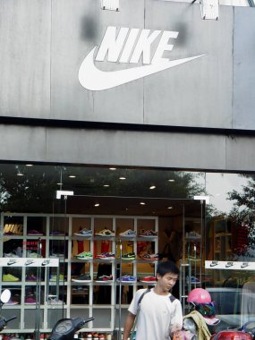 A customer leaves a sportswear store of Nike in Haikou city, south Chinas Hainan province, 25 October 2012.