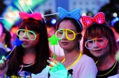 Young Chinese people wearing illuminous decorations take part in a 15km night parade to celebrate the 94th anniversary of the founding of the Communist Party of China (CPC) in Fangchenggang city, south Chinas Guangxi Zhuang Autonomous Region, 1 July