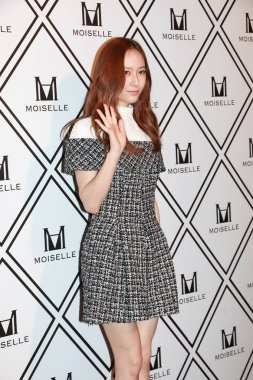 American singer and actress Krystal Jung Soo-jung of South Korean girl group f(x) poses as she arrives for a promotional event by fashion brand Moiselle in Hong Kong, China, 10 September 2015.