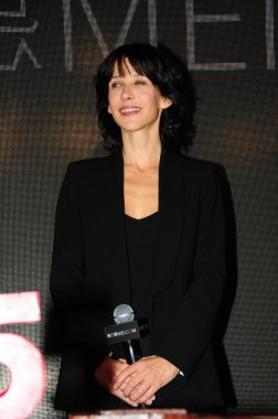 French actress Sophie Marceau smiles during a celebration event for the fifth anniversary of Chinese luxury fashion shopping site mei.com in Shanghai, China, 21 April 2015.