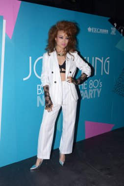 Hong Kong singer Joey Yung poses during a promotional event for her new EP