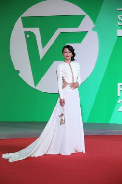 Chinese actress Zhou Xun poses on the red carpet for the closing ceremony of the 21th Shanghai Television Festival in Shanghai, China, 12 June 2015.