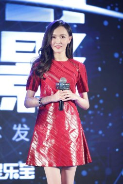 Chinese actress Tang Yan, wearing a Louis Vuitton dress, poses during a press conference for her movie
