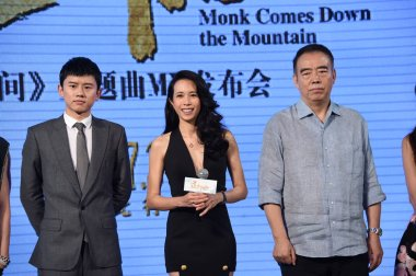 (From left) Chinese singer Zhang Jie, Hong Kong singer and actress Karen Mok and Chinese director Chen Kaige pose during a press conference for the music video of their movie