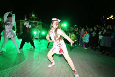 Young people dressed in Halloween costumes take part in a party to celebrate Halloween in Weifang city, east China's Shandong province, 25 October 2015