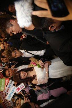 Japanese singer Ayumi Hamasaki, left, is surrounded by reporters at the Taipei Songshan Airport after arriving in Taipei, Taiwan, 14 February 2015.