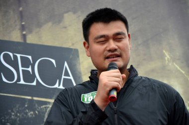 Retired Chinese basketball superstar Yao Ming speaks during the ceremony to start the challenge of running 100 marathons in 100 consecutive days in Guangzhou city, south China's Guangdong province, 2 April 2015