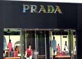 A customer leaves a Prada boutique in Shanghai, China, 29 June 2011
