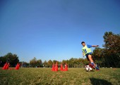 --FILE--A young Chinese boy practises during a training session at Jiangsu Guoxin Parma International Football School in Nanjing city, east Chinas Jiangsu province, 24 October 2014