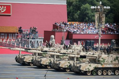 Self-propelled howitzers march past the Tiananmen Rostrum during the military parade to commemorate the 70th anniversary of the victory in the Chinese People's War of Resistance Against Japanese Aggression in Beijing, China, 3 September 2015