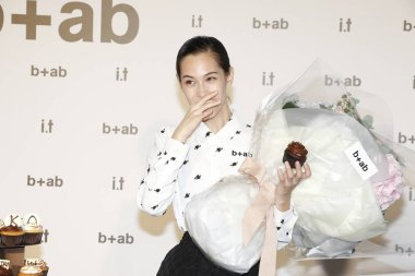 Japanese model and actress Kiko Mizuhara eats a cup cake prepared to celebrate her upcoming 25th birthday at a fashion show for the Spring/Summer 2016 collection of b+ab in Hong Kong, China, 12 October 2015.