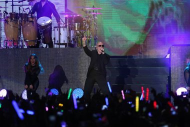 American rapper Armando Christian Perez, better known by his stage name Pitbull, performs with sexy dancers at his concert in Taipei, Taiwan, 24 March 2015.