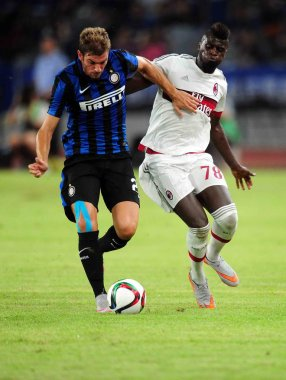 Hamady Niang M'baye of AC Milan, back, challenges Davide Santon of Inter Milan, left, Martnez Delgado of Inter Milan in a soccer match between AC Milan and Inter Milan during the 2015 International Champions Cup China in Shenzhen city