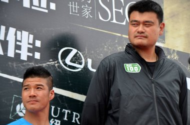 China's first international ultra-marathon champion Chen Penbin, left, and retired Chinese basketball superstar Yao Ming attend the ceremony to start the challenge of running 100 marathons in 100 consecutive days in Guangzhou city, south China's Guan