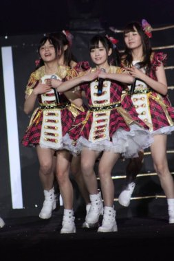 Members of idol group SNH48, a sister group of Japanese pop girl group AKB48, perform at the