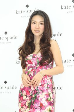 Hong Kong singer and actress Fiona Sit poses as she arrives for a preview of Kate Spade fall collections in Hong Kong, China, 3 July 2014.