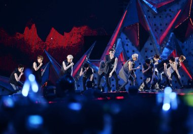 Members of South Korean-Chinese K-pop boy band EXO perform at their concert in Chengdu city, southwest Chinas Sichuan province, 5 July 2014.