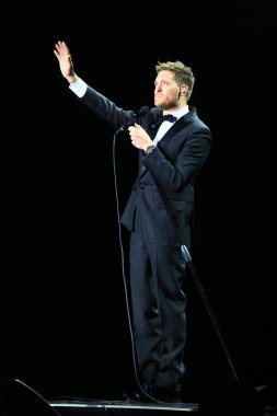Canadian singer Michael Buble waves at his concert in Shanghai, China, 13 January 2015.