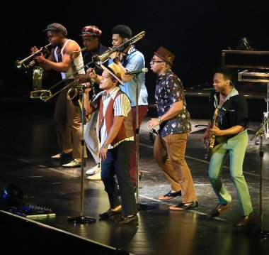 American singer Peter Gene Hernandez, front, known by his stage name Bruno Mars, performs with other entertainers during his Moonshine Jungle concert at Mercedes-Benz Arena in Shanghai, China, 3 April 2014.