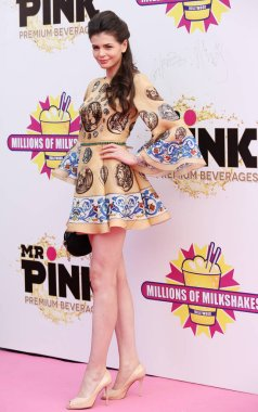 Romanian model Monica Gabor poses as she arrives at the opening ceremony for a new milk shake store of Millions of Milkshakes in Shanghai, China, 28 May 2014.