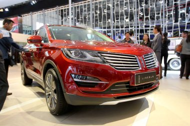 Visitors look at a Lincoln MKC during the 13th Beijing International Automotive Exhibition, also known as Auto China 2014, in Beijing, China, 20 April 2014