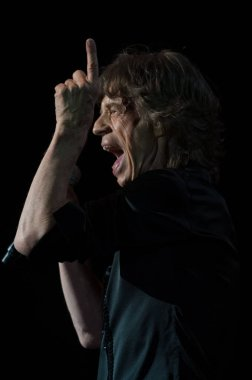 Mick Jagger of English rock band The Rolling Stones performs at the concert of their world tour, 14 On Fire, in Macau, China, 9 March 2014