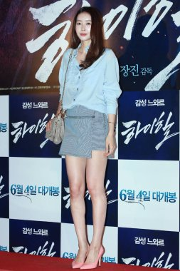 South Korean actress Wang Ji-hye poses on the red carpet for the VIP premiere of movie, Man on High Heels, in Seoul, South Korea, 2 June 2014.