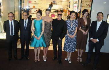 (From third left to second right) Chinese actress Gao Yuanyuan, Australian model Miranda Kerr, American fashion designer Michael Kors, Hong Kong actress Carina Lau, Taiwanese model and actress Lin Chi-ling pose during the opening ceremony for the fla