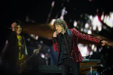 Mick Jagger, right, and Ronnie Wood of English rock band The Rolling Stones perform at the concert of their world tour, 14 On Fire, in Macau, China, 9 March 2014